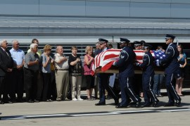 Members of the Scott Air Force Base, Illinois, Honor Guard transport the remains of Airman 3rd Class Howard Martin during a dignified arrival at the Indianapolis International Airport July 10, 2014. Martin died during a C-124 crash in 1952 and his remains were recovered earlier in 2014.