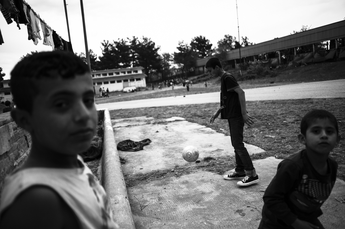 Idomeni - Greece april 2016 -kids playng ball at old rail station camp