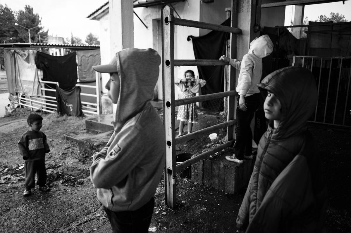 idomeni - Greece april2016 - kids standing at the old rail station camp after the rainstorm