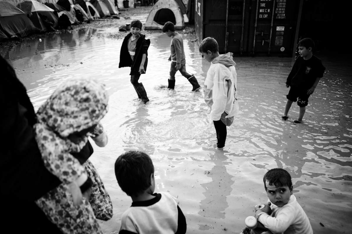 Idomeni - Greece april 2016 - kids playing after rainstorm