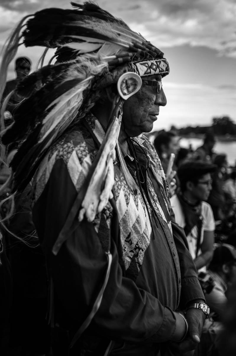 Chief Arvol Looking Horse greeting the tribes arriving at Standing Rock on their canoes to support Sioux Tribe's effort to stop the pipeline