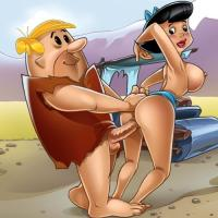 Ample cocked Barney sticks his salami into wifey Betty from behind.Her tradmark blue sundress is pulled down below her ample boobies which are stiffly jutting out and down over her ample chubby shaply caboose.Barney also has a forearm inserted up Betty´s