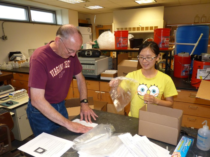 Dr. Jeffrey Parks and Min Tang work on putting lead kits together