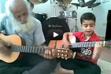 Little-kids-jam-session-with-his-grandpa