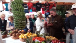 The chef, and passengers, browsing and tasting fruits.