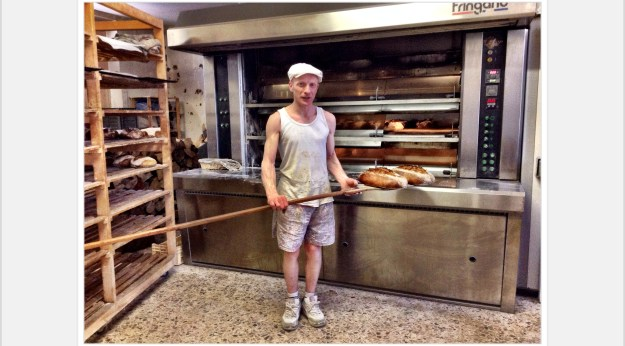 Renee in front of his oven at Pain de Molitg