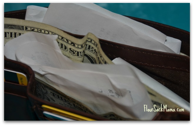wallet stuffed with receipts & dollar bills