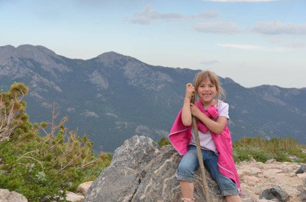 girl with walking stick on mountain
