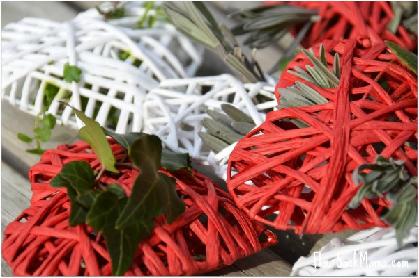 red and white hearts with fresh greenery