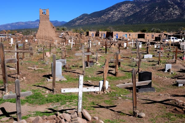 The ruins of the 17th century St. Jerome Church stand in the middle of the cemetery at Taos Pueblo, an ancient Native American community near the modern city of Taos, New Mexico.