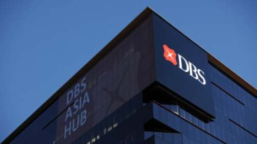 :The DBS Group Holdings Ltd. logo is displayed atop the company's DBS Asia Hub building in Singapore, on Thursday, Feb. 9, 2012.
