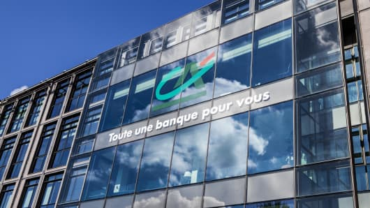 Credit Agricole earnings  Q4 net profits climb despite one time tax hit Credit Agricole