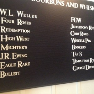 Q's chalkboard list of bourbons