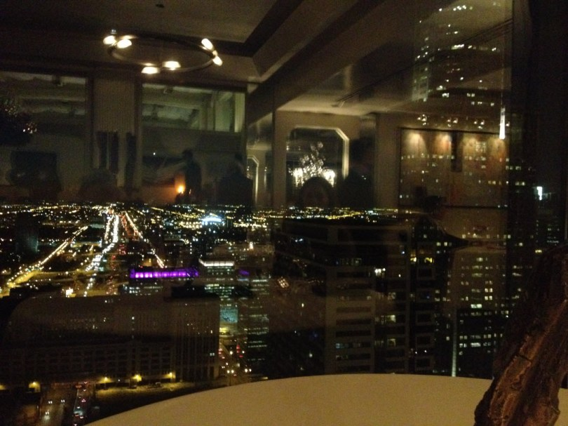 Everest's elegant dining room reflected in the night city view