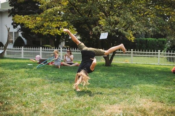 one-handed cartwheel girl