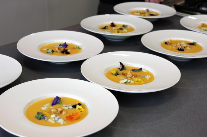 Pumpkin pear soup with Rokari blue cheese and edible flowers