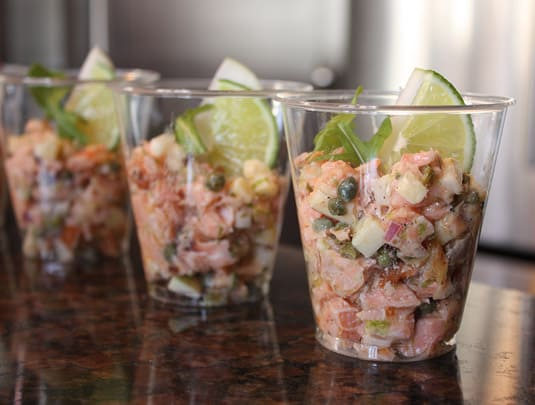 Tartare of marinated trout and smoked salmon with apples and aged cheddar cheese