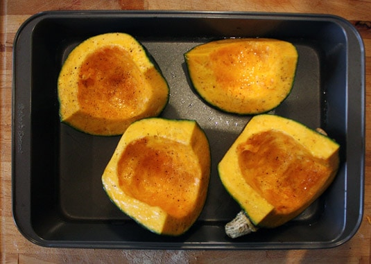 Quartered, oiled, salted and peppered buttercup squash before roasting.