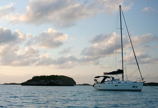 Our sailboat, the Congo, as the sun sets on Warderick Wells Cay.