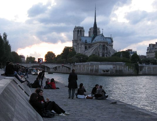 While watching the sun set over Notre-Dame.