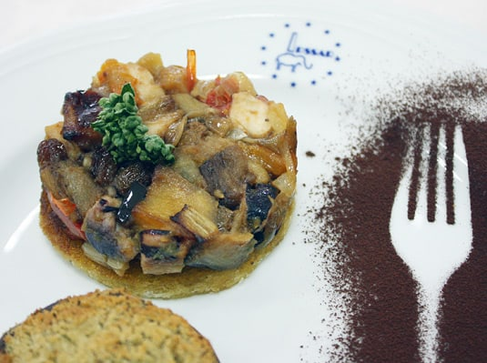 Traditional Sicilian caponata with eggplant, onions, raisins, and cocoa.