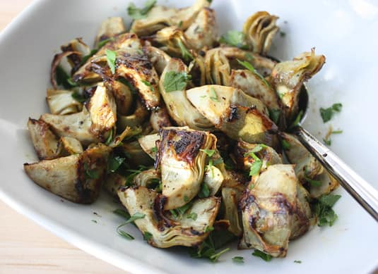 sauté the artichokes for about 5 minutes over medium-high heat, or until tender and golden-brown in spots. Remove from the heat and stir in the chopped parsley