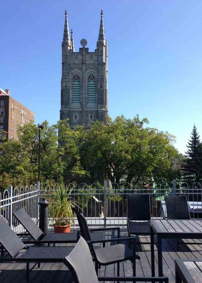 The sunny terrace of Auberge du Quartier, one of the Best Boutique Hotels in Quebec City // FoodNouveau.com