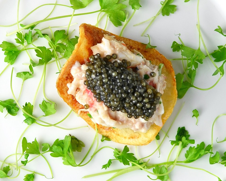 Signature Russian Amuse-Bouche: Potato Chip, King Crab, Brains, and Caviar