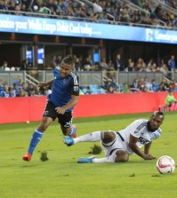 Quincy Amarikwa evades Kendall Watson's challenge.
