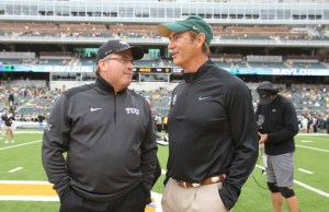 Baylor coach Art Briles, right and TCU Gary Patterson talks before their NCAA college football game, Saturday, Oct. 11, 2014, in Waco, Texas. (AP Photo/Jerry Larson) 04222015xSPORTS