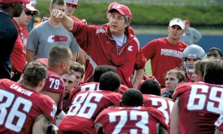 Washington State University head football coach, Mike Leach, talks with his players during the WSU Crimson and Gray Football Game, Saturday, April 21, 2012 in Spokane, Wash.  (AP Photo/Dan Pelle)