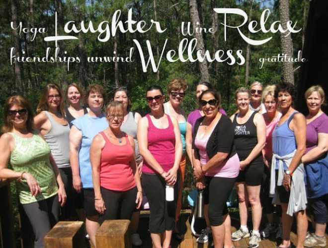 women standing on porch smiling dressed in yoga attire
