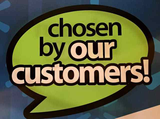 A blue and green sign that says Chosen by our Customers - this was for a Expo hosted by Walmart