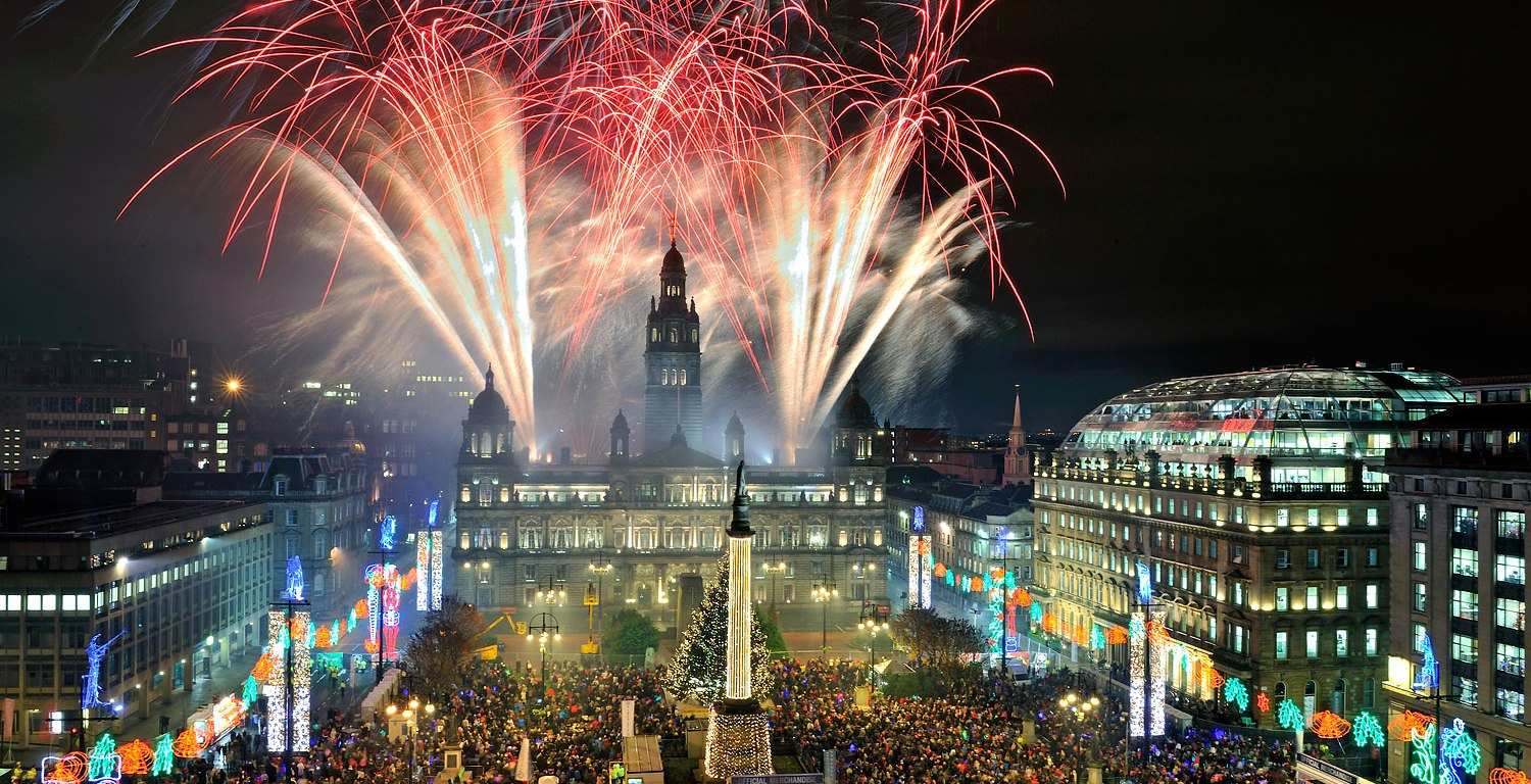 Glasgow, United Kingdom. 15th November 2012 -- Fireworks shoot off as the Christmas lighst are switched on. -- The countdown to Glasgows official Christmas celebrations is underway as the spectacular Christmas lights switch-on is unveiled in George Square. Around 15,000 people have secured a free golden ticket. Anthony Brawley—Demotix/Corbis