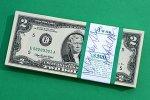 Two dollar bills.
