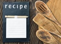 kitchen utensils and a notepad to write a recipe