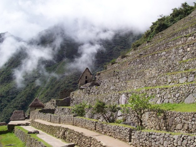 Agricultural zone and stone buildings at Machu Picchu, Urubamba Province, Peru