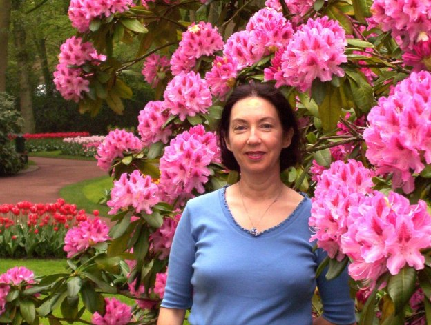 Jean standing beside a Rhododendron bush at Keukenhof Gardens in the Netherlands.