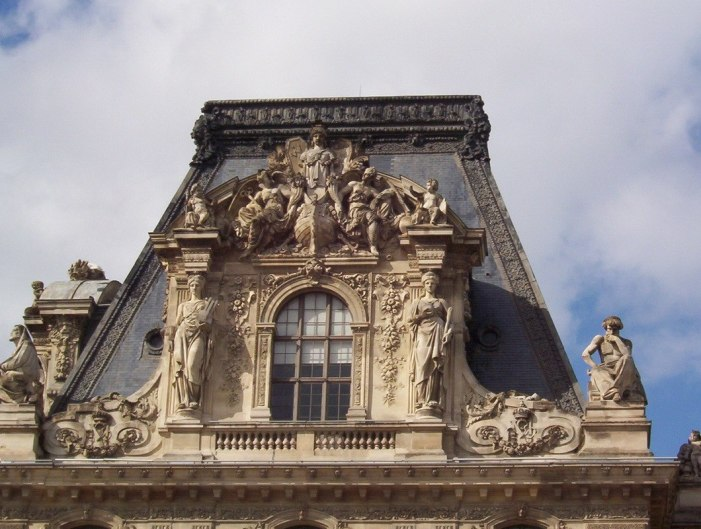 Louvre - stone carvings above windows - Paris - France