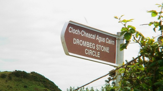 Direction sign at the Drombeg Stone Circle east of Glandore, County Cork, Ireland.