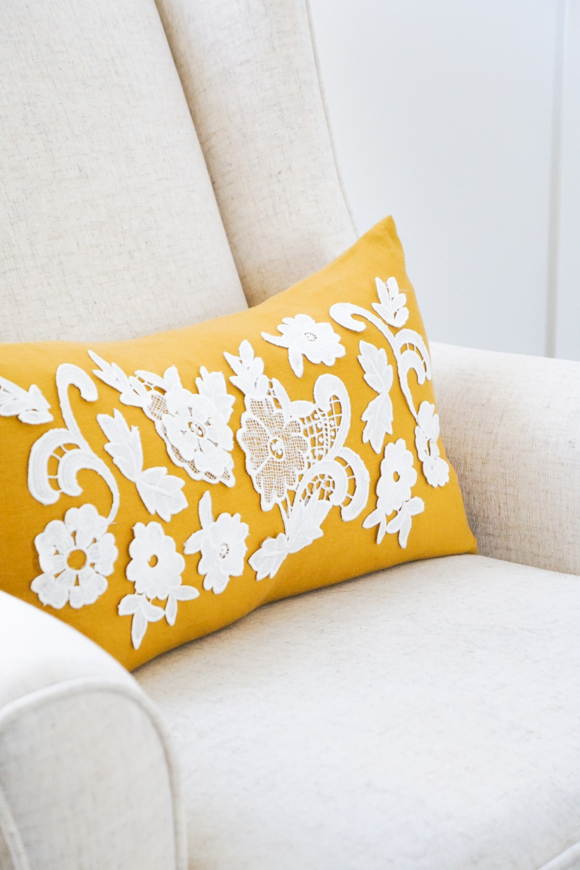 DIY a beautiful lace applique pillow for your home or nursery with bridal lace. Click for all the details!