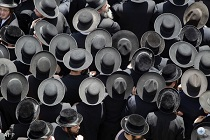 Ultra-Orthodox Jews take part in a rally in the central Israeli city of Bnei Brak on June 17, 2010 where tens of thousands of religious Israelis were protesting against a Supreme Court ruling which ordered the jailing of a group of Ashkenazi parents of European origin who are refusing to send their daughters to a school with Jewish girls of Middle Eastern, or Sephardic, descent. AFP PHOTO/JACK GUEZ