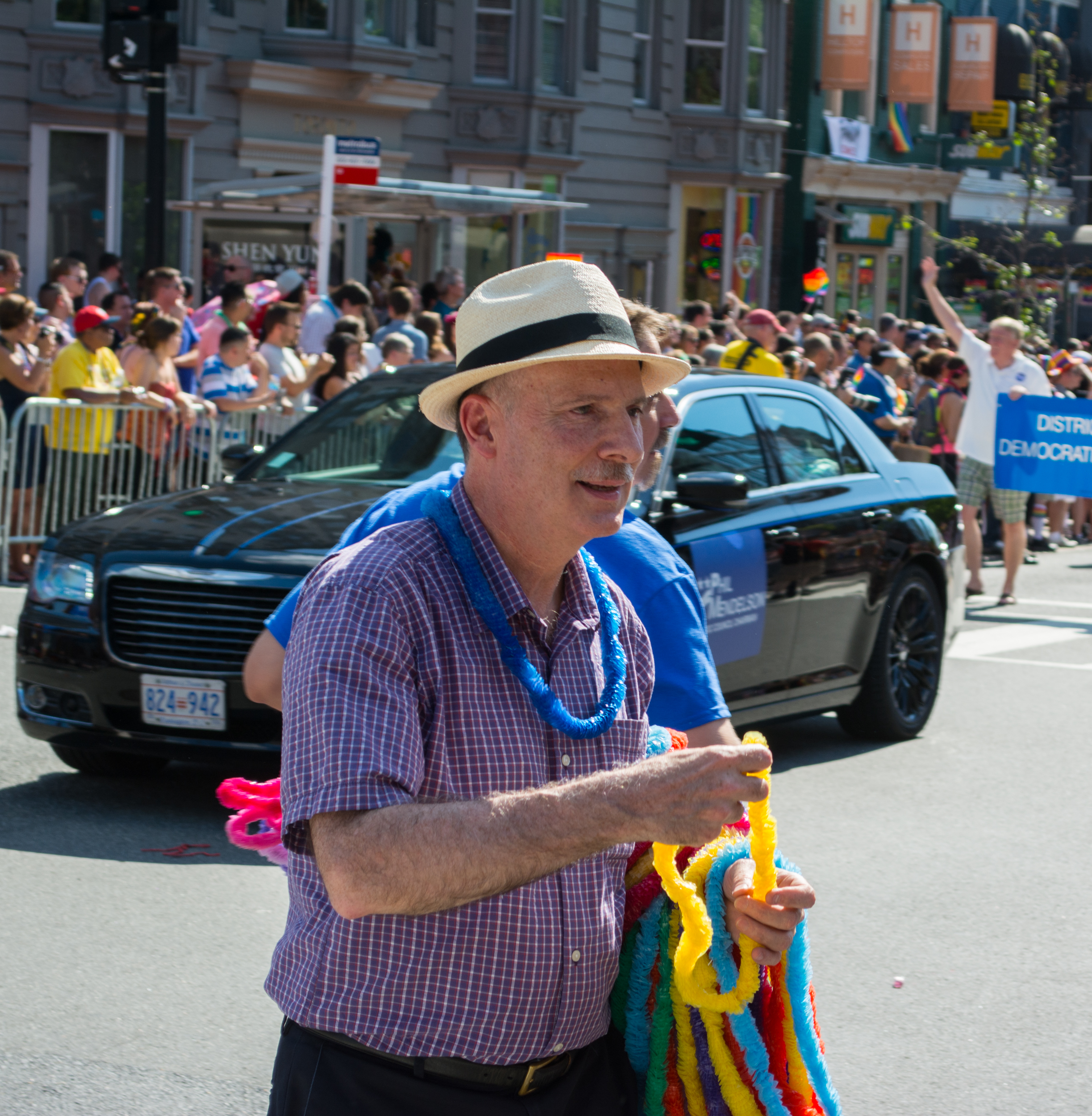 Phil Mendelson, Chairman of the Council of the District of Columbia, hands out necklaces and plastic leis to bystanders in the the Capital Pride gay pride parade on June 7, 2014, in Washington, D.C., in the United States. (Photo by Tim Evanson [CC BY-SA 2.0 (http://creativecommons.org/licenses/by-sa/2.0)], via Wikimedia Commons)