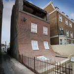 Slipping facade by Alex Chinneck