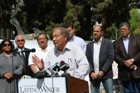 "Mendota Mayor Robert Silva joins other elected officials who are members of the California Latino Water Coalition April 1 in voicing concerns about the West Side's water supply cutbacks during a well-covered Fresno news conference. Also speaking were Reps. Jim Costa and David Valadao, Supervisors Phil Larson of Fresno County and Richard Valle of Kings County, along with Clovis City Council Member and former Mayor Jose Flores. Silva spoke about the Bureau of Reclamation's recent reduction in the West Side's water supply from 25% to 20% and said, ""Do we want more welfare, more food stamps, more unemployment? No. We want the 5% back, plus 10% more."""