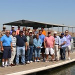 Members of the Fresno County Council of Governments  complete a boat tour to the site of the proposed Temperance Flat Dam August 9, accompanied by Friant Water Authority Assistant General Manager Mario Santoyo (first row, far left).