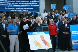 Assembly Minority Leader Connie Conway (R-Tulare) addresses the rally as Assembly Member Henry T. Perea looks on.