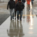 Walking in the rain to the Tulare water forum on March 26.