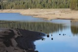 Southern California Edison Company's Huntington Lake, at the 7,000 foot elevation in Fresno County, is usually nearly full until Labor Day. Because of the drought, its storage as July was concluding was less than 42% of its capacity.