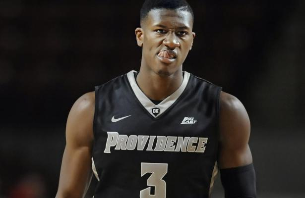 Providence's Kris Dunn reacts after hitting a three-point basket in the second half of an NCAA college basketball game against Massachusetts, Monday, Dec. 21, 2015, in Amherst, Mass. Providence won 90-66. (AP Photo/Jessica Hill)